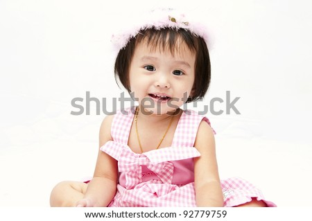 Little baby girl with a furry crown - stock photo