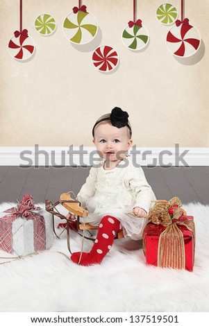 Little baby girl with gifts and Christmas balls - Christmas photos - stock photo
