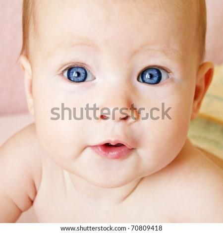 Little Baby Girl with hair stuck up taken closeup - stock photo