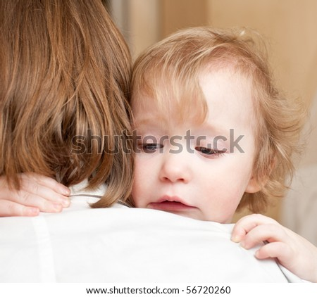 Little baby girl with her mother, shallow focus - stock photo