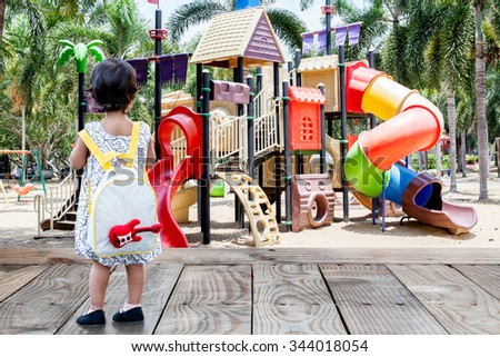 Little Baby Girl With School Bag Go To The Playground
