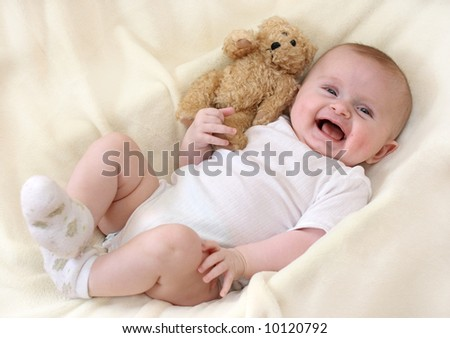 Little baby girl with teddy - stock photo