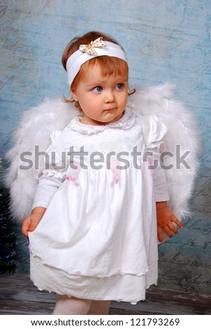 little baby girl with white wings as angel - stock photo