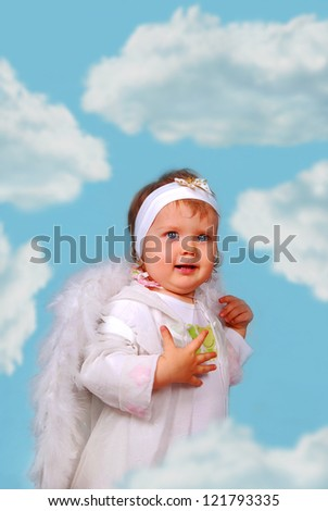 little baby girl with white wings as angel among the clouds - stock photo