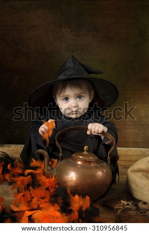 Little baby halloween witch - stock photo