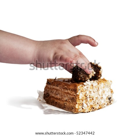 little baby hand picks cake - stock photo