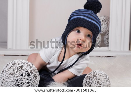 little baby in Christmas socks and cap