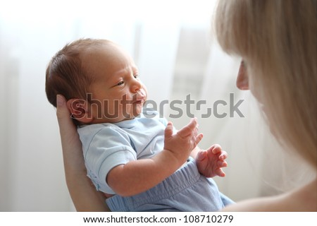 Little baby in mother's hands - stock photo