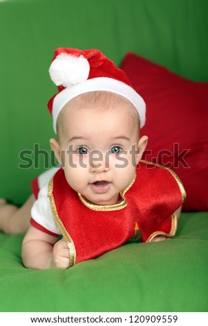 Little baby in Santa Hat - stock photo