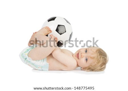 Little baby is playing with a ball. - stock photo