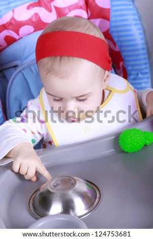 Little baby learn to eat food - stock photo