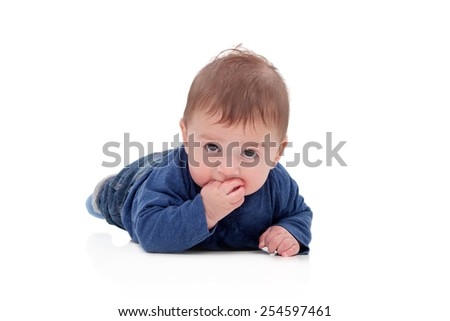 Little baby lying on the floor isolated on a white background - stock photo