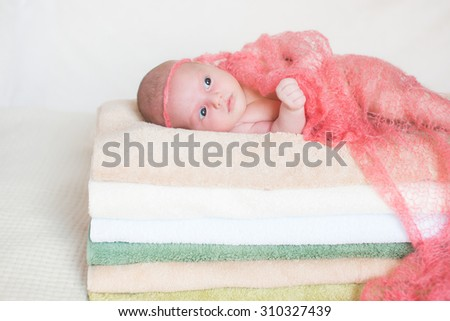 little baby lying on towels. The girl sees sweet dreams. Happy childhood - stock photo