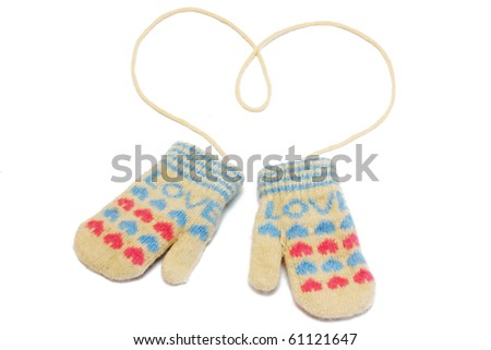Little baby mittens/gloves isolated on white background - stock photo