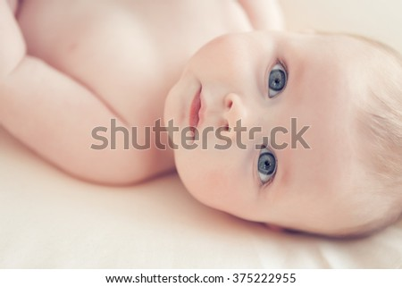 little baby on a blanket - stock photo
