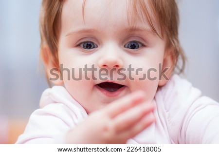 little baby on a blue background. positive emotions