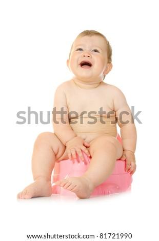 Little baby on chamberpot - stock photo