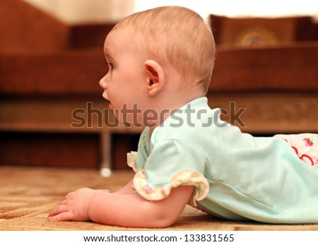 Little Baby on the Floor in Home Interior - stock photo