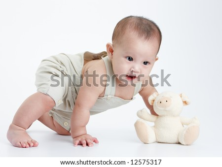 little baby play alone, a studio shot