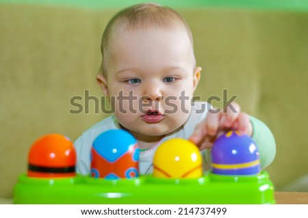 little baby play with her toy - stock photo
