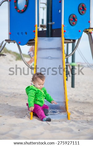 little baby playing in the beach - stock photo