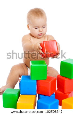 Little baby playing with cubes, isolated on white - stock photo