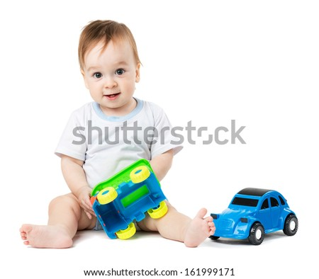 little baby playing with toy cars