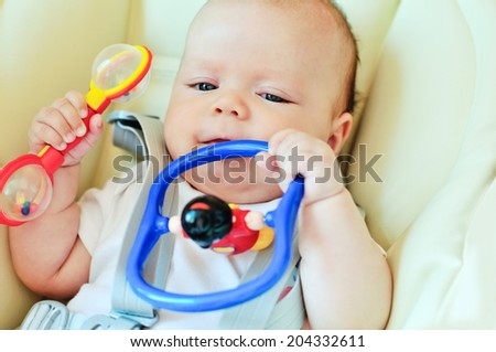 little baby playing with toys - stock photo