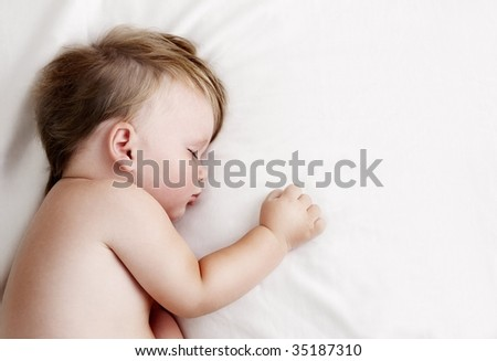 Little baby sleeping and having sweet dreams - stock photo