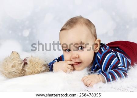Little baby sucking finger - stock photo