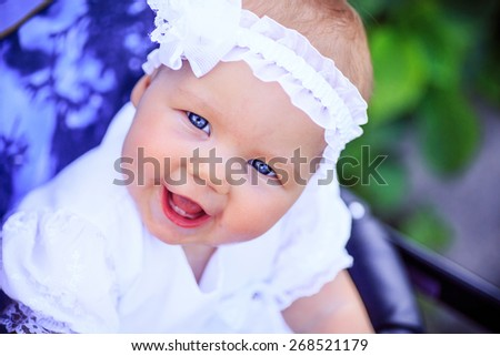 little baby with blue eyes - stock photo