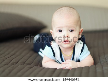 little baby with crossed hands - stock photo