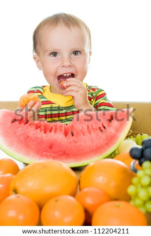 little baby with fruits, close up,  concept of health care and healthy child nutrition