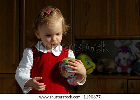 Little baby with her ball - stock photo