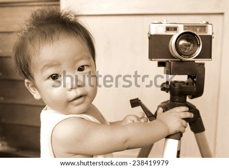 little baby with  photo camera - stock photo