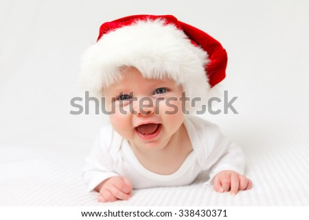 little baby with santas hat laughing out loud - stock photo