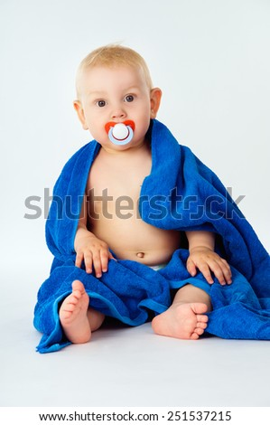 Little baby wrapped bright blue towel - stock photo
