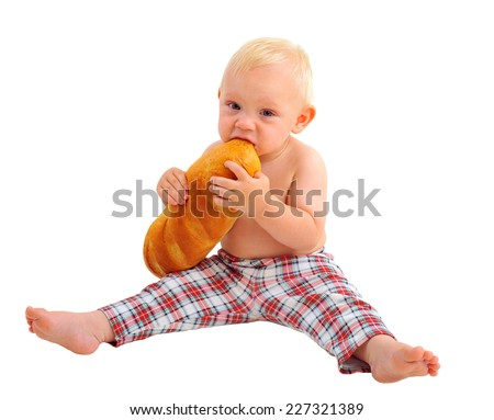 Little baker baby boy with a long loaf dressed in plaid pants, isolated on white background  - stock photo