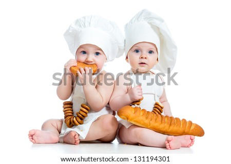 Little bakers kids boy and girl - stock photo