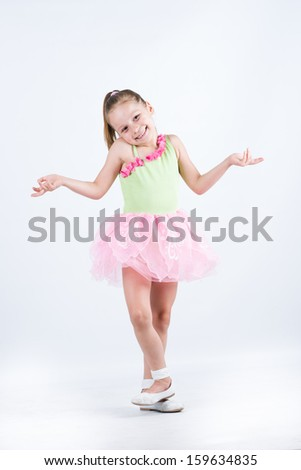 Little ballerina girl smiling and posing