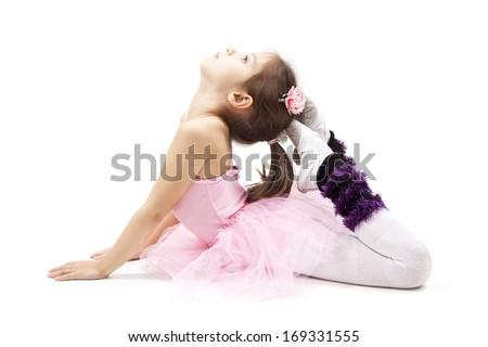 Little ballerina making exercises, cute girl - stock photo