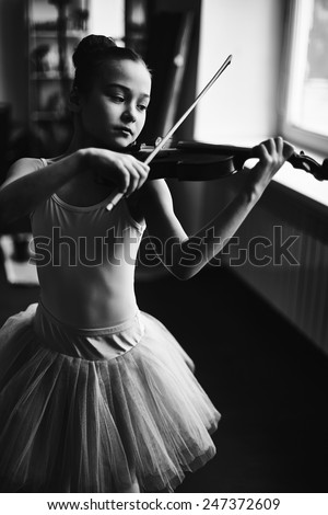 Little ballerina playing the violin - stock photo