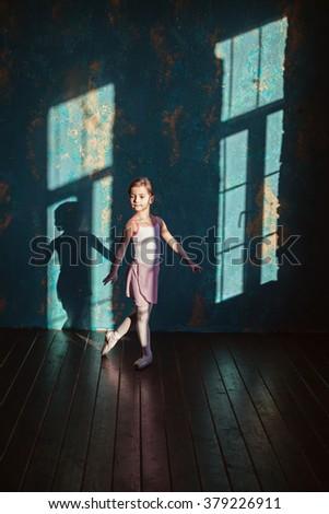 Little ballerina, young girl ballet dancer - Harmonious pretty preteen girl with tutu dancing and posing in loft studio - Contemporary dance performer - window shade - natural light - stock photo