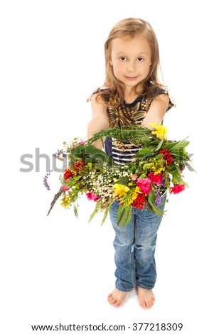 Little barefoot girl holding in her outstretched arms a large, beautiful flower wreath - Isolated on white background
