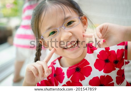 Little beautiful asian girl with glasses - stock photo
