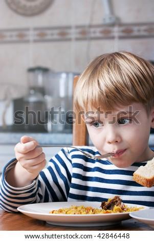little beautiful boy eating - stock photo