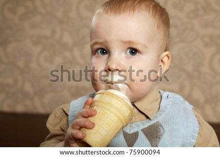 little beautiful boy eats icecream - stock photo