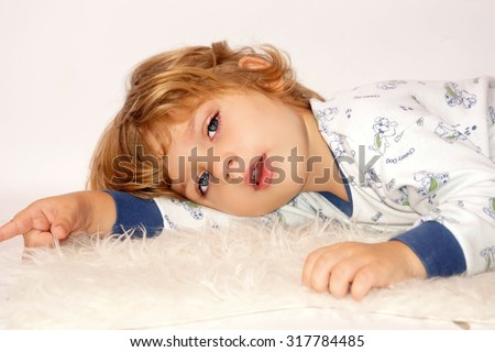 Little beautiful boy in pajamas - stock photo