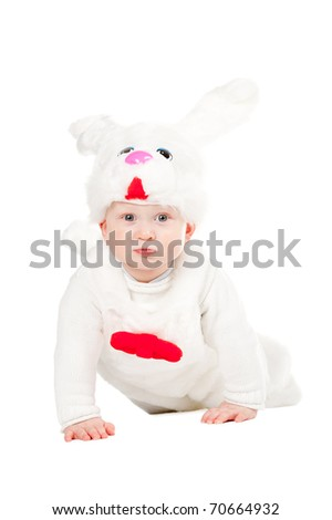little beautiful boy in rabbit costume with carrot - stock photo