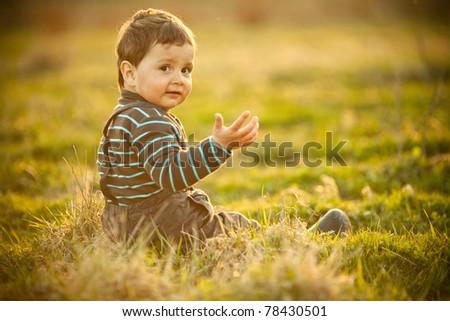 little beautiful boy on field - stock photo